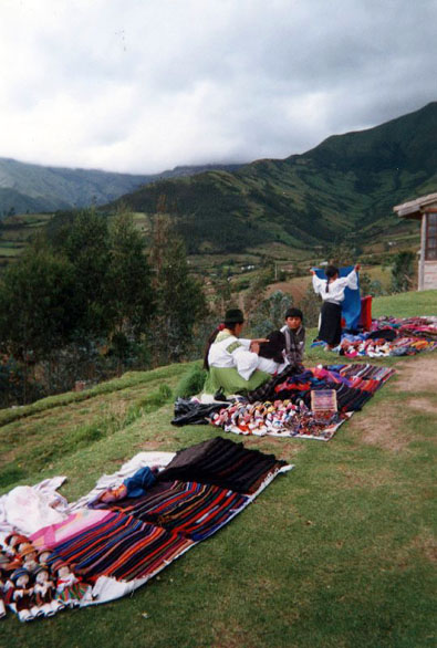 Haggling is not only fun, it's expected. Here village women ply   their handcrafts. Ecuador highlands.
