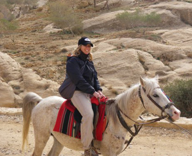 Erin  engaged on a horse